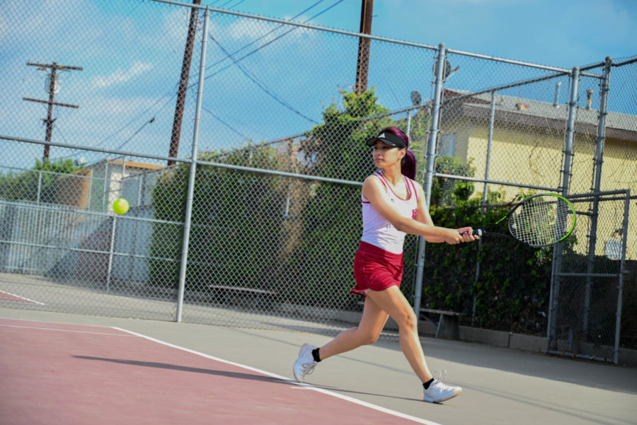 During period 5, Irene Lee practices her strokes in preparation for her doubles match later that afternoon.