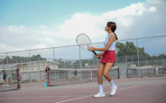 Jasmine Cheysobhon watches the ball head to her opponent's court during the practice match before the game.