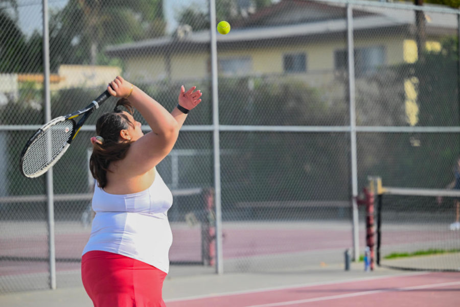 Varsity player Veronika Verdyan serves the ball to the Spartans during her doubles match with partner Van Handke.